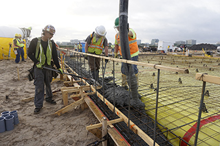 Concrete being poured at first Rental Car Service Center