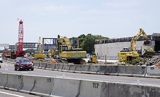 Middle span of Taxiway J bridge demolished