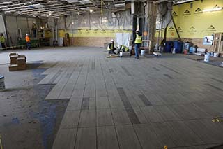 Tile being set for P.F. Chang's space