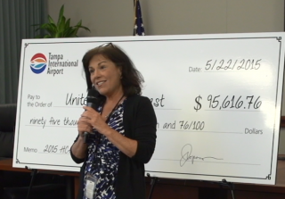 Janet Zink presents the check to United Way