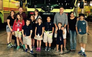 School bus heroes at firestation
